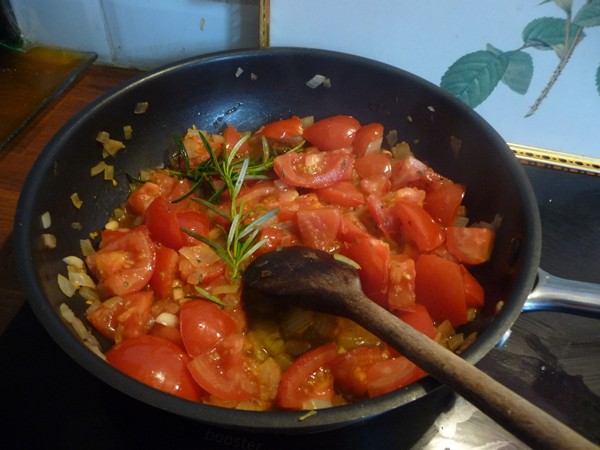 Cooking the tomatoes and onion