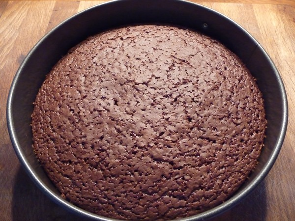 Vegan chocolate cake to be transferred to cooking rack