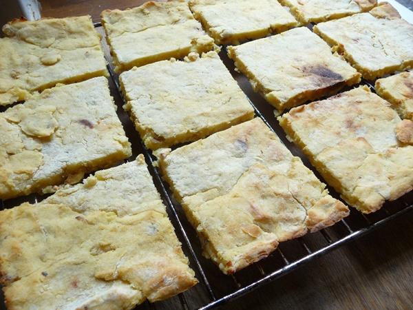 Cheesy potato cakes cooling